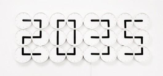 The Clock Clock turns a wall of analog clocks into digital art ...